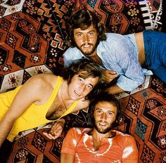 Photo of BEE GEES posed in 1971 Top to bottom Barry Gibb Robin Gibb Maurice Gibb