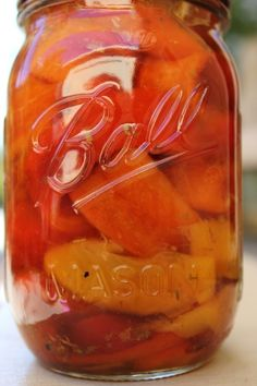 Char-Roasted Pickled Peppers...  6-8 sweet bell peppers (about 2 pounds);  1 large clove garlic, unpeeled;  1/2 cup dry white wine;  1/2 cup white vinegar;  1/2 cup apple cider vinegar;  1/2 cup sliced onion;  2 tbsps sugar;  1/2 tbsp dried oregano;  1 tsp pickling salt