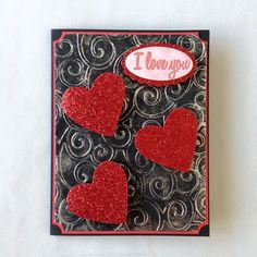 Hearts - Idea: Could quill the background and glue flat, sparkly hearts on top of the quilled background, as well as an I love you stamp, cut out.