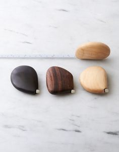 This wooden pebble-shaped tape measure offers a smooth finish and natural appearance, it feels like a perfect skipping stone in the hand. It is not only beautiful, but functional as well. A perfect gift for anyone, not just knitters!
