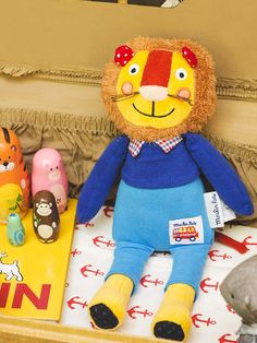 French Stuffed Lion - Dressed in his handsome blue sweater, this plush lion with his fuzzy and wild mane has traveled all the way from France just to play with you! With his funny, friendly grin and super plush body, take this well-traveled lion home with you and we promise he will be a favorite cuddle and playtime friend! - See more at: http://poshchicago.com/collections/new-arrivals/products/french-lion-doll#sthash.rEf02Afa.dpuf