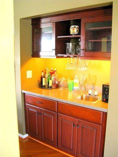 Butler's pantry in cherry built-in to an unused alcove for a great bar space