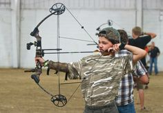 Trent Hockman, 11, from Pueblo takes aim during the Pueblo County Fair archery competition held at the Colorado State Fair livestock pavilion. (Chieftain photo by John Jaques, July 7, 2012)