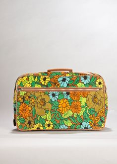 Here's another 1960's flower suitcase showing the zipper. It even came with a tiny key for the lock.