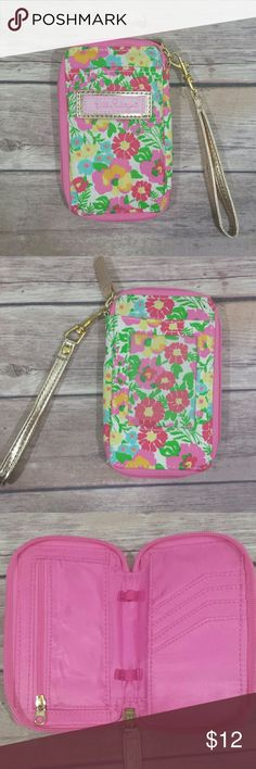 Lilly pulitzer wristlet carded ID wallet Lilly pulitzer wristlet carded ID wallet with zip around gold strap. Didnt fit all my cards. Used once in excellent condition. From smoke and pet free home. No trades. Thank you! Lilly Pulitzer Bags Wallets