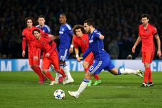 Eden Hazard of Chelsea scores his team's second goal from the penalty spot during the UEFA Champions League round of 16 second leg match between Chelsea and Paris Saint-Germain at Stamford Bridge on March 11, 2015 in London, England.