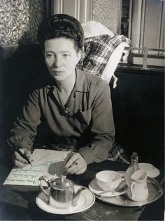 Portrait of Simone de Beauvoir, Café de Flore, Paris, c. 1945. pictured by Brassaï