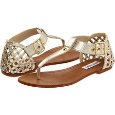 These remind me a pair of gold sandals I had as as little girl - > Steve Madden Suttle in Dusty Gold