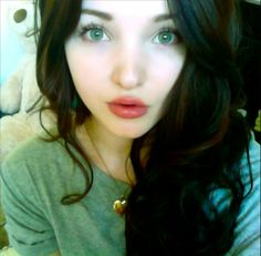 I think Dove Cameron looked better with dark hair but she's beautiful either way