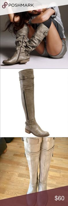 """Steven by Steve Madden Sabra boots Steven by Steve Madden Sabra style boots.  Exposed zipper sides accent a beautifully structured over-the-knee boot. Accented with buckle straps at the collar and heel. Pull-on style with partial, side-zip closure. Approx heel height 1"""". Boot scar height  21"""".  Calf circumference 15"""". Excellent condition. Lovingly cared for. Color is same as, and more accurately represented by the model pic.  My lighting is simply different. Steven By Steve Madden Shoes Over…"""