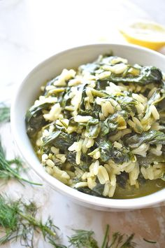 Greek Spinach Rice is a very healthy and nutritious dish made with rice, spinach, onion, dill, lemon juice and olive oil. Light, yet very fulfilling, this Greek rice recipe can be served either as a main or side dish. It takes less than 30 minutes to cook, all in one pot which makes it an ideal quick and easy dinner!