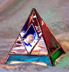The Dreamweaver Pyramid Lamp is the right size for a night light or accent lamp to radiate a soft glow of calming cool colors.