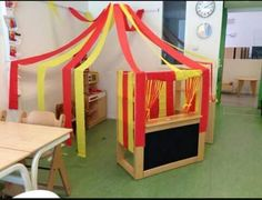 Circus tent in corner with streamers