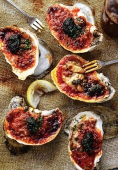 "BYERS' FIRE-ROASTED GULF OYSTERS in GUAJILLO CHILE GARLIC BUTTER with MEXICAN CHORIZO & CHIPOTLE SALSA ~~~ this recipe is shared with us from the book, ""smoke"". [Tim Byres] [USA, Southwest Cuisine, Modern] [wsj]"