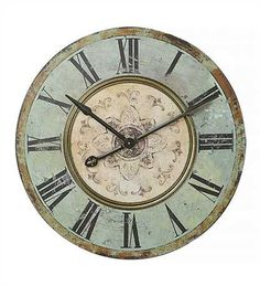 """Dimensions: 29"""" diameter This working clock has amazing details! The fading paint and distressed edges, combined with the classic vintage green paint scream french country."""