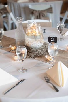 Crackle glass with floating gold votives, pearls, sand and gold/silver mercury glass votives