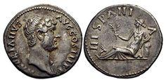 """Se dice que el término """"España"""" viene del latín """"Hispania"""", y este a su vez, del fenicio """"i-spn-ya"""". Significa """"tierra de conejos"""" debido a la gran cantidad de conejos que poblaban el país. Desde tiempos antiguos, los romanos relacionaron España con el aceite de oliva y los conejos. Como prueba de ello, compartimos con vosotros esta imagen de una moneda conmemorando la visita del emperador Adriano a Hispania, donde se ve a una persona sujetando una rama de oliva y un conejo a sus pies."""