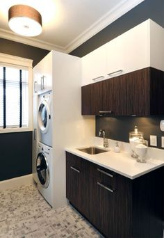 love the modern mix of cabinetry in this laundry room!