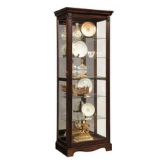 The classic style and warm cherry finish of this curio make it adaptable to many settings. The front of the case is constructed with a two-way sliding door with lock. The back of the case is mirrored. Five adjustable glass shelves can be found in theinterior, along with one halogen can light with a roll-switch. The case is decorated with reeded pilasters, rosettes and elegant trim and moldings.