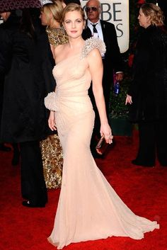 65 Best Golden Globe dresses of all time -     DREW BARRYMORE -   A Globe winner for her role in Grey Gardens, Drew Barrymore topping the best-dressed list in her stunning Atelier Versace nude gown. (2010)
