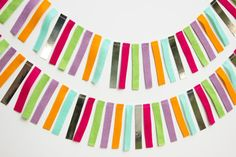 A festive garland made from strips of felt and silver foil cardstock paper. Each of the strips is about 4 inches long and is sewn together to make a 6 ft. garland.