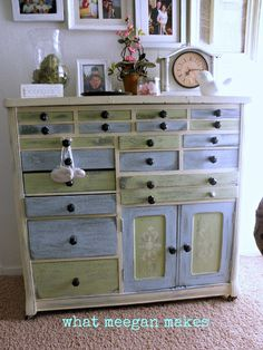 "The core of the cupboard is painted Antique White.  The silver drawers and cupboard doors with ""Hint of Olive"" by Ace Hardware! Gorgeous"