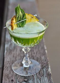Recipe for Fever Pitch Cocktail, with cachaca, pineapple, basil, green chartreuse, lime, egg white, and celery bitters. Brazilian-themed for the World Cup! #cocktailrecipes