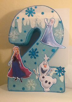 Number piñata decorate Frozen. Frozen piñata. Frozen birthday party. Frozen decoración.