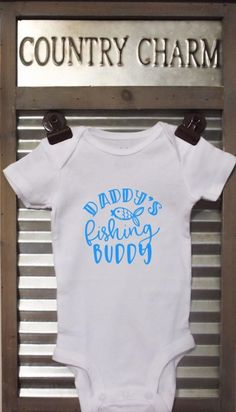 Daddys Fishing Buddy baby bodysuit. This bodysuit is a perfect baby shower gift  *Bodysuits are Carter's brand. Please see their sizing chart if you aren't sure what size to order. *All bodysuits are white. The color you choose is for the text/image. *If you would like a colored bodysuit, please Football Baby, Football Season, Cotton Headed Ninny Muggins, Handmade Baby Items, Kids Beanies, Knitted Baby Clothes, Baby Shirts, Baby Accessories, Funny Babies