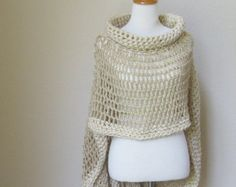 This beautiful poncho was handmade using a combination of yarns and variety of stitches and crochet . This intricate design is fashionable and unique