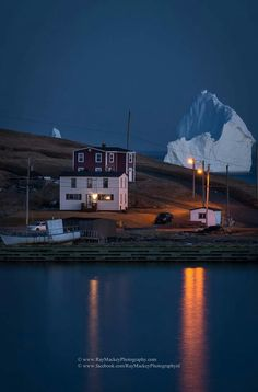 Droves of tourists are flocking to Ferryland, Canada, to witness a behemoth iceberg that has planted itself just off the tiny town's shore. Small Town America, North America, Ice Giant, Topsail Beach, Newfoundland And Labrador, Newfoundland Canada, Nature Images, Nova Scotia, Vacation Destinations