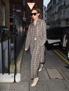Victoria Beckham wearing a check coat and trousers from her pre fall 2017 collection.