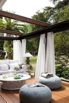 Pergola patios are a popular trend because they provide some shade and are easy to hang objects like curtains and lights from. This outdoor room gives you the homey feeling of your living room with a backyard breeze. Outdoor Rooms, Outdoor Dining, Outdoor Gardens, Outdoor Decor, Outdoor Furniture, Outdoor Pergola, Outdoor Seating, Outdoor Lounge, Wooden Pergola