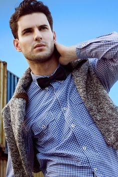Oscar Alvarez—blue checkered shirt with dark and solid bow tie.