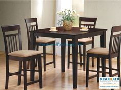 Duncan Cappuccino Pub Table Collection by Coaster This lovely dining set will be a welcome addition to your casual contemporary home. The sleek square table has smooth edges and tapered square legs for a sophisticated style. The four matching counter height chairs feature high slatted backs and soft padded seats covered in durable deep mocha colored microfiber that will blend nicely with any decor.