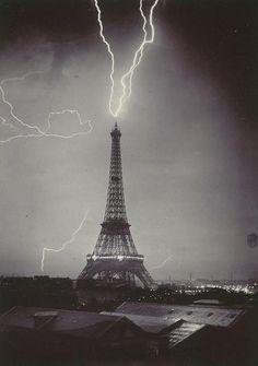 The Eiffel tower struck by lightning, 1902 (Photo by Gabriel Loppé)