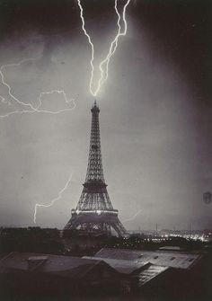 The Eiffel tower struck by lightning, 1902 (Photo by Gabriel Loppé)