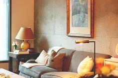 studio apartment- exposed concrete walls