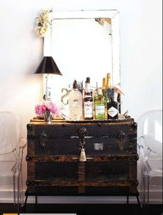 elevated old trunk + lucite + venetian mirror