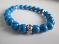 Blue Howlite and sparkly silver bracelet elastic cording. Howlite is said to help to reduce anxiety, tensions and stress. Howlite can be used to facilitate awareness, encourage emotional expression and assist in the elimination of pain, stress.