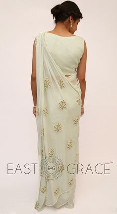 Classy girls wear pearls. We took it to a higher level and embedded them with touch, love, and care on the serene Pearl & Icy Mint Saree that's made with sheer yet royal pure silk chiffon. This saree will help you stun with a little laid-back glamour and complement your simplicity with ease. PRICE: INR 6,528.00; USD 96.00 To buy click here: goo.gl/sTqjeC For order related inquiries, please reach out to us at orders@eastandgra.... With love, EAST & GRACE www.eastandgrace.com