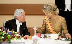 Engaging: Queen Maxima seemed engrossed in conversation with Emperor Akihito at the State Dinner given in honor of the Dutch King and Queen in Tokyo, 29 October 2014.