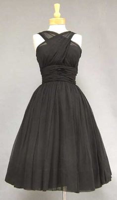 Lovely black dress.    To do -   Get a functional sewing machine, learn how to use it, learn how to drape effectively...and then make things I see like this.