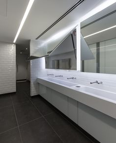 Corian trough style vanity units and Tego folding mirrors.