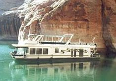Lake Powell Houseboat!-I think this would be a dream vacation,I can see Chris and Jess doing cannonballs off the boat and racing to who can get to the jet ski first.