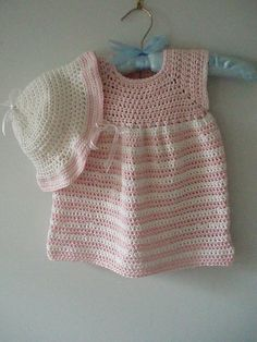 This is a crochet pattern for a summer baby dress in pink and white stripes and a matching sunhat. Sizes 6 to 12 months and 1 to 2 years.  The dress pictured is worked in a cotton blend yarn, but you can use any light worsted or DK yarn.  This is a basic dress pattern and general and quite easy, instructions are given for making it for older girls.