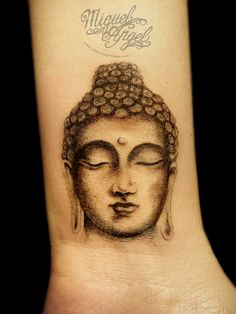 2 inches Buddha head on inside of the wrist. A custom tattoo by Miguel Angel.