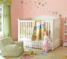I like this with baby's name above the crib with the butterfly decals