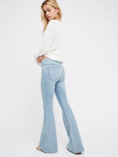 Penny Pull-On Flare | Classic Free People pull-on flare jeans featured in a clean silhouette with an extreme flare with a slight stretch. Back pockets and back knee seam detailing. This mid-rise style has an elastic waistband for an easy fit.