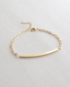 Simple Curved Bar Bracelet by Olive Yew. This sleek bracelet is adjustable from 7 - 8 inches and available in silver or gold.